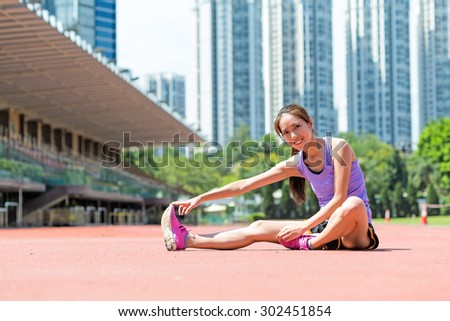 Woman do stretching exercise on legs at outdoor - stock photo