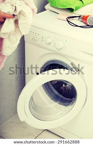 Woman do washing in a washing machine - stock photo
