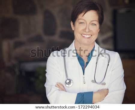 Woman doctor at home - stock photo
