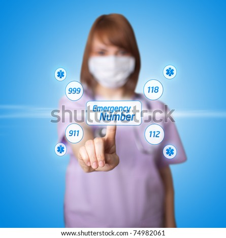 woman doctor pressing digital button ( Emergency Number ) - stock photo