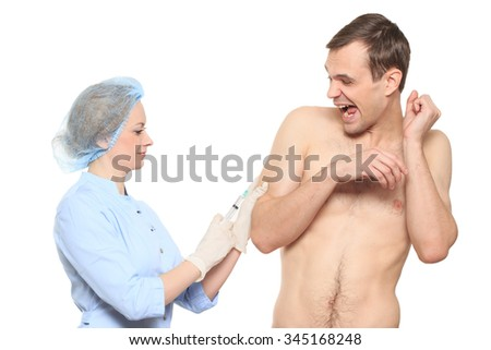 Woman doctor puts a prick. The man is afraid and feels panic. Isolated on white background.  - stock photo