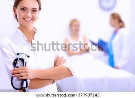 Woman doctor standing at hospital
