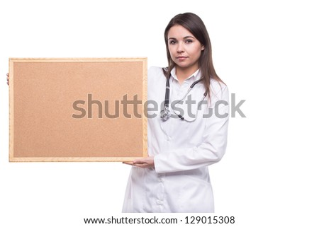 Woman doctor with blank board - stock photo