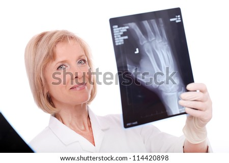Woman doctor with xray image over white background - stock photo