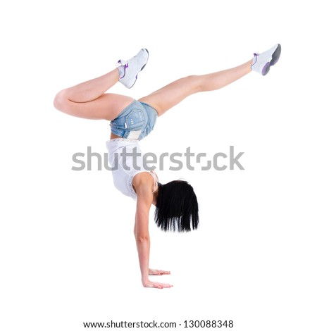 woman does a gymnastic handstand