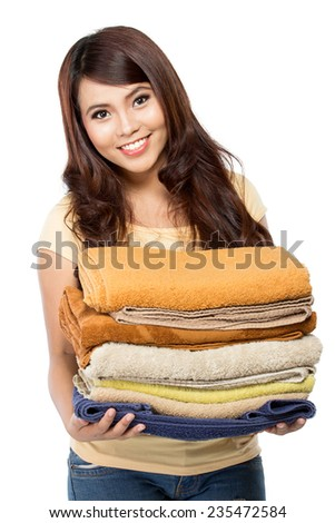 woman doing a housework holding laundry isolated over white background - stock photo