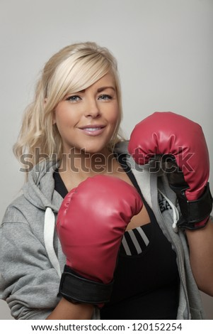 woman doing boxing training to keep in shape - stock photo