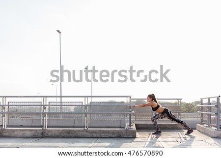 Woman doing core stretching exercise on the street