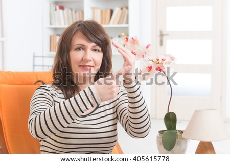 Woman doing EFT on the karate chop point. Emotional Freedom Techniques, tapping, a form of counseling intervention that draws on various theories of alternative medicine.  - stock photo