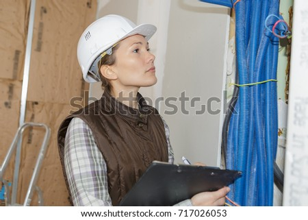 woman doing electrical inspection