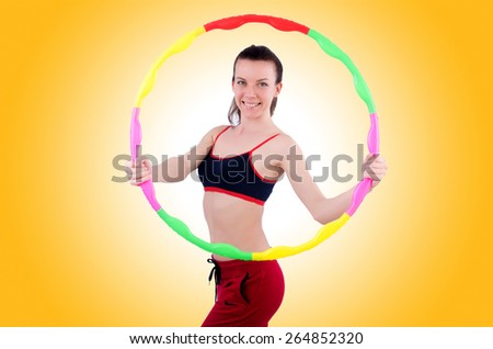 Woman doing exercises with hula hoop - stock photo