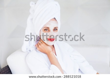 woman doing face mask at home - stock photo