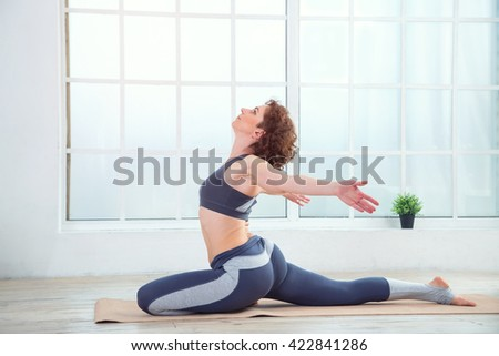 woman doing fitness exercises home senior stock photo