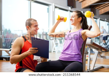 Woman doing fitness in a gym - stock photo