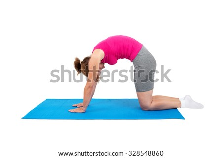 Woman doing gymnastics - cat's arched back - stock photo