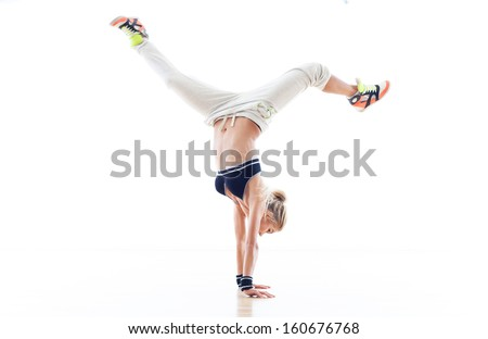 Woman doing handstand - stock photo