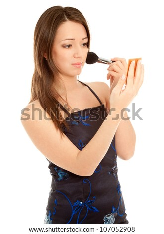 Woman doing her make up  isolated - stock photo