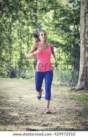 Woman doing jogging exercises in nature