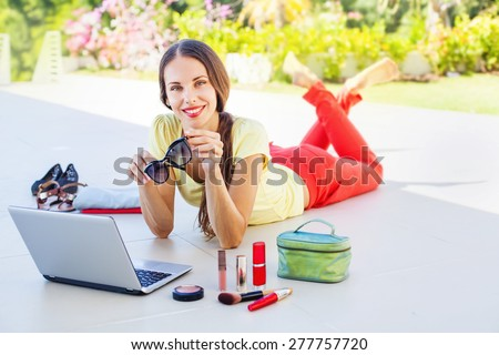 Woman doing online shopping, she received her order - stock photo