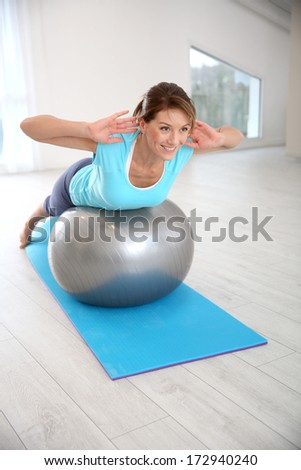 Woman doing pilates and balance exercises - stock photo