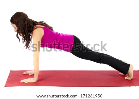 Woman doing plank pose (Series with the same model available) - stock photo