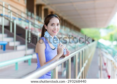 Woman doing sport at stadium