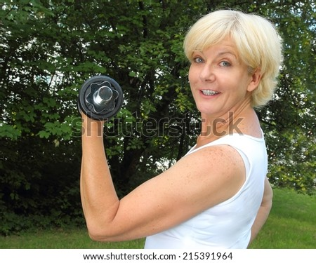 Woman doing sports with dumbbell - stock photo