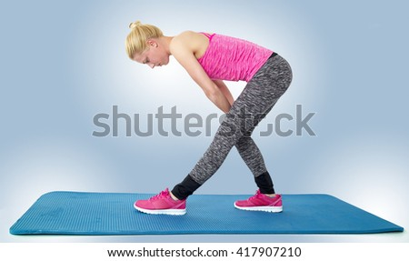 Woman doing stretching exercises isolated on a white background. - stock photo