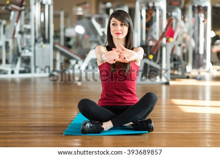 Woman doing stretching in a gym