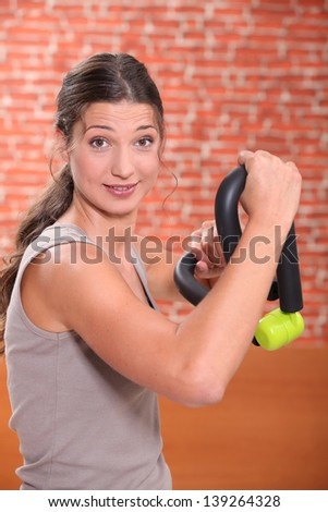 Woman doing weight training - stock photo