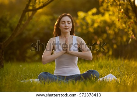 Woman doing yoga at park
