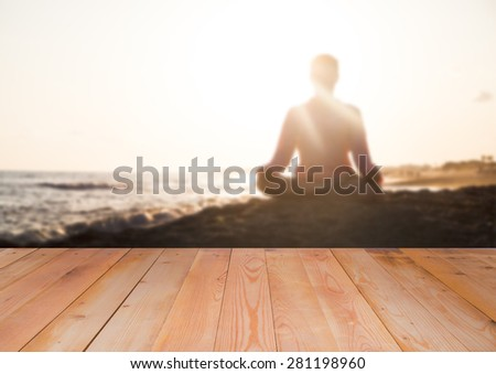 Woman doing yoga at sunset time, blurred background - stock photo