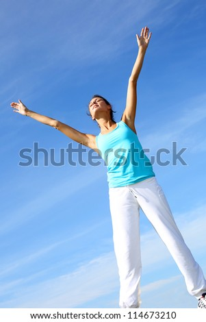 woman doing yoga exercises in countryside