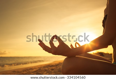 Woman doing yoga in a beautiful setting.  - stock photo