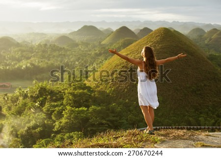 woman doing yoga in The Chocolate Hills. Bohol, Philippines - stock photo
