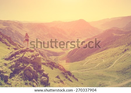 Woman doing yoga in the mountains - stock photo