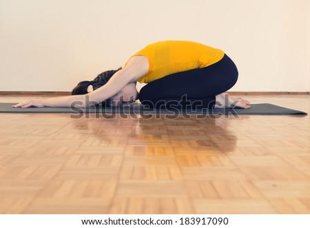 Woman doing yoga indoors. - stock photo
