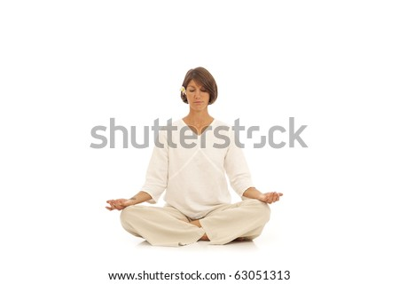 Woman doing yoga isolated against white - stock photo