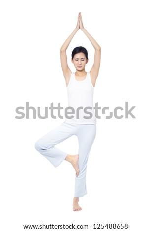 Woman doing yoga isolated on white - stock photo