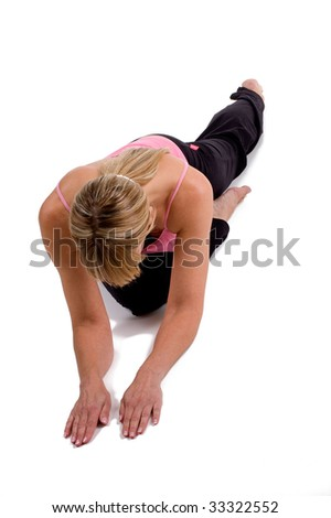 Woman doing yoga on white background