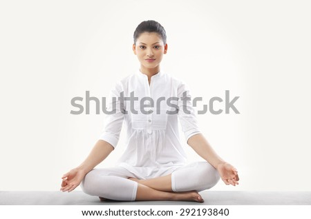 Woman doing yoga over white background - stock photo