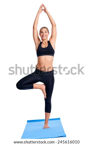 Woman doing yoga poses isolated on white background - stock photo