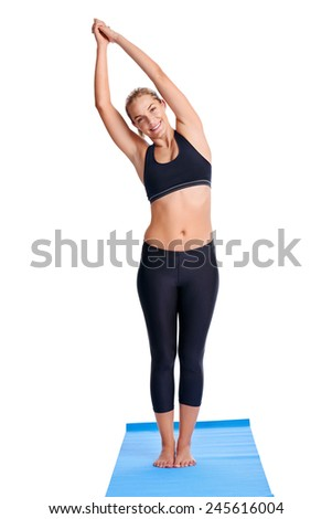 Woman doing yoga poses with mat isolated on white background - stock photo