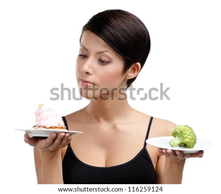 Woman doubts between tasty cake and healthy broccoli, isolated on white - stock photo