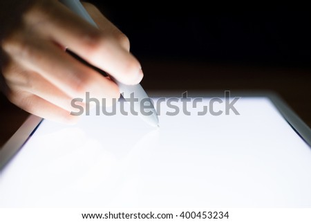 Woman drawing something on tablet pc