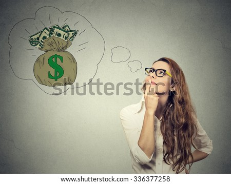 Woman dreaming of financial success  - stock photo