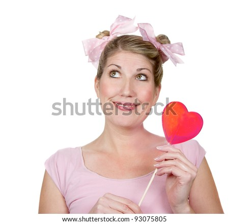 Woman dressed as a child holding a heart