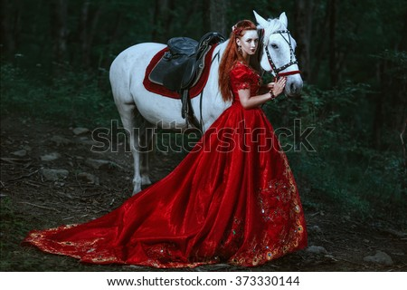 Woman dressed in medieval dress - stock photo