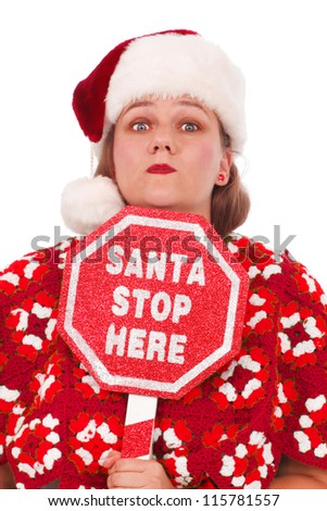Woman dressed in red Christmas colors with a sign Santa Stop Here