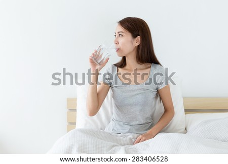 Woman drink a glass of water at morning - stock photo
